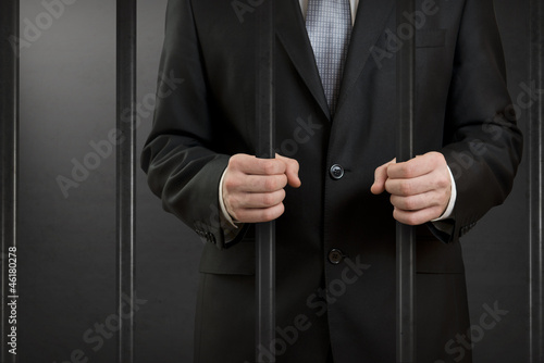 Businessman in jail close up