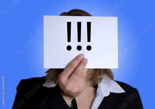 businesswoman holds a banner with interrogation marks