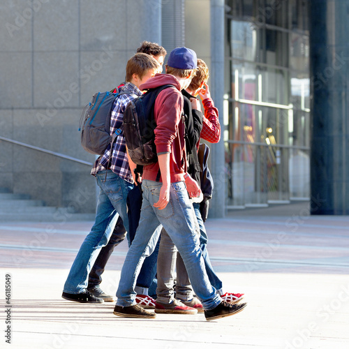 A group of young people walking on the background of the urban l
