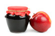 Red apple and pot of jam isolated on white background
