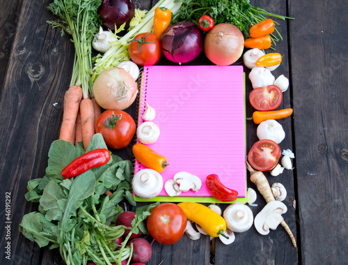 Pink paper for recipes on wood backround and vegetable