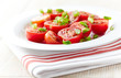 Fresh tomatoes with spring onion on a plate