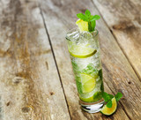 Fototapety Mojito with a slice of lime on a wooden table