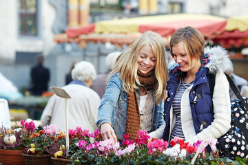 two young women looking at the cyclamen