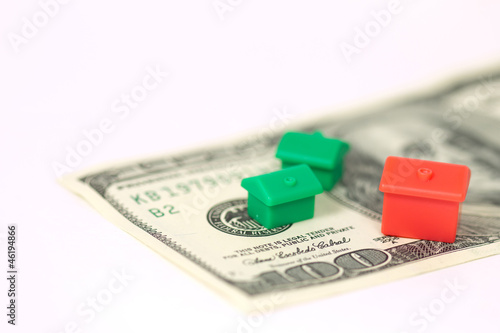 Monopoly houses and hotel on 100 dollar banknote