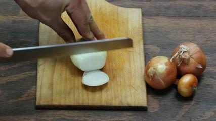 onion slices on a cutting board