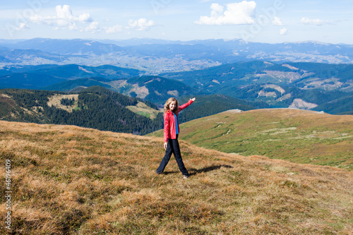 Woman tourist welcome gesture hands a hiking to the mountains