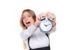 woman holding alarm clock in panic