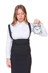 sleepy businesswoman holding alarm clock