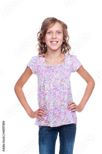 smiley little girl in jeans isolated