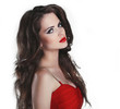 Portrait of beautiful brunette woman with red lips and curly hai