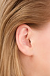 blonde woman ear closeup