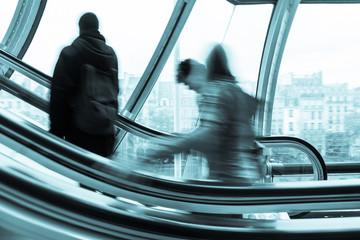Blurred People on the Escalator