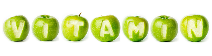 "Word ""vitamin"" made of green apples."