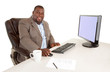 Smiling African American Businessman Sitting at Desk