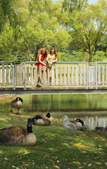 Teen on a bridge