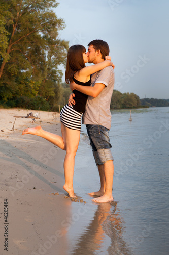 Couple hugging and kissing at riverside