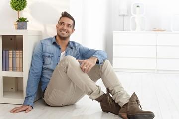 Happy man daydreaming at home
