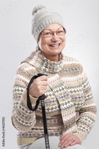 Happy old woman hiking