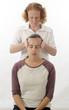 Постер, плакат: Kinesiologist treating Neuro vascular holding