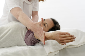Kinesiologist treating Trapezius