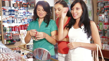 Female Customers Choosing Hair Dye in Beauty Department
