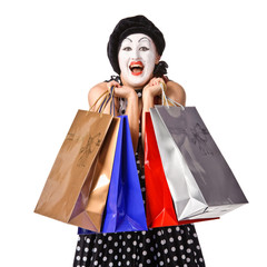 Happy mime in spotty dress holding shopping bags