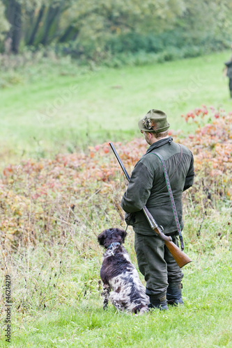 hunter with his dog hunting