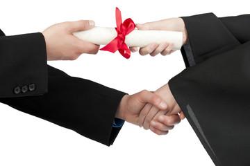 graduating student hand accepting diploma