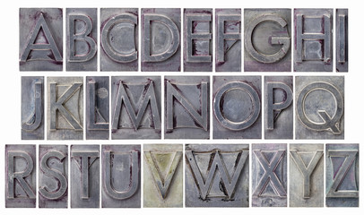 alphabet in grunge metal type