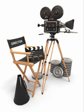 composition du film. Appareil photo vintage, la chaise du directeur et bobines.