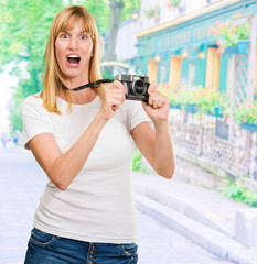 Shocked Woman With Old Camera