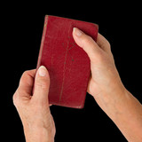 Fototapety Old hands (woman) holding a very old bible