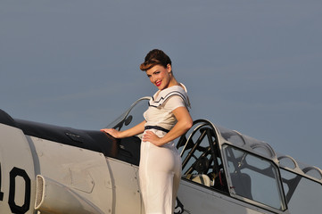 retro navy girl with a vintage aircraft