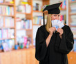 graduate woman holding euro notes