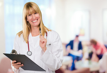 happy female doctor holding a clipboard
