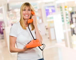 Happy Woman Holding Telephone