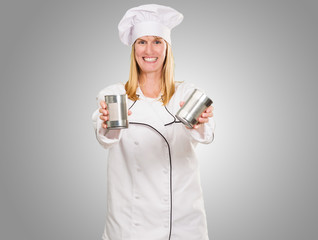 Female Chef Holding Tin