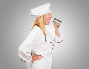 Female Chef Holding Tin Shouting