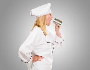 Female Chef Holding Tin Shouting