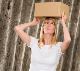 woman holding a box on her head