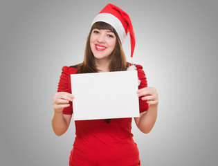happy christmas woman holding a blank card