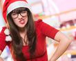 angry christmas woman wearing glasses