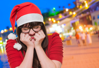 excited christmas woman with her eyes shut