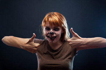 Funny zombie girl showing thumbs up