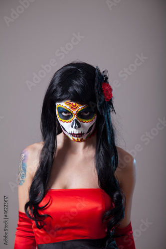 Young woman with sugar skull Halloween make-up