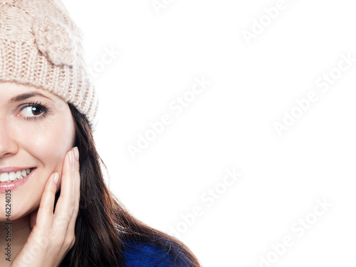 Young woman with hat is looking to the right