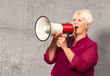 Portrait Of A Senior Woman With Megaphone