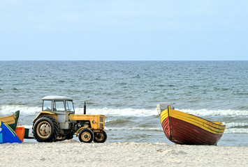 Tractor and boat on the beach