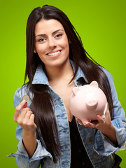 Portrait Of A Female Holding A Coin And Piggybank